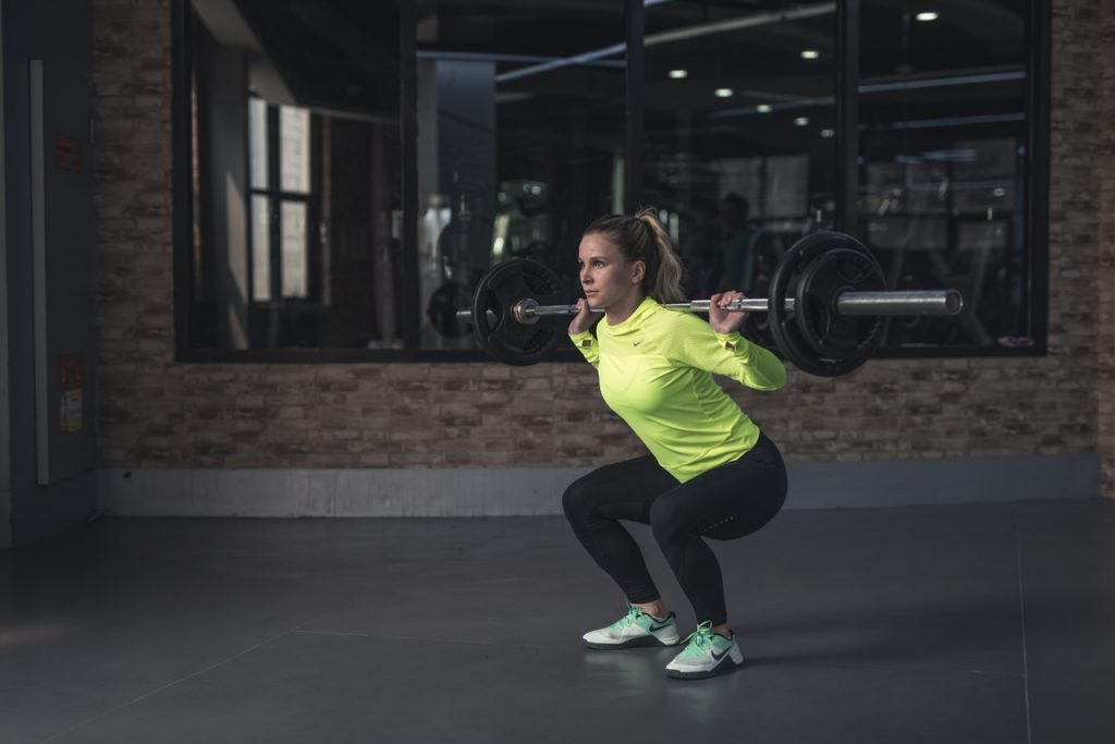 woman doing leg exercises in gym