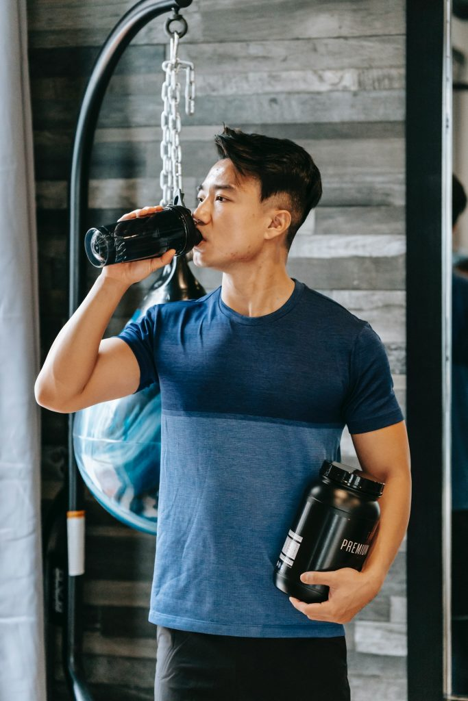 man drinking protein after workout